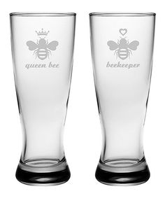 Sip on your favorite spirits with this set of pilsner glasses boasting a sand-etched message for a cheeky touch.