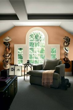 Dark shades of gray dominate in this upstairs den, but a blush shade on the far wall with the window lightens the mood. | Brown Sugar (10-22), @prattandlambert