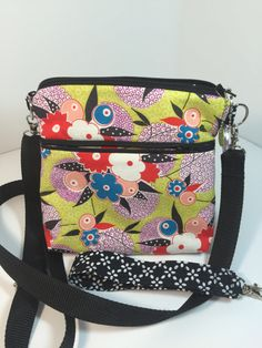 BRAND NEW DESIGN!!!!  ..... Just a tad roomier than our other mini-bag.... this bag has a larger profile by a couple of inches and just that