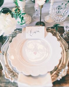 Ornate, romantic place setting and beautiful calligraphy place card. Image by Rachel May Photography.