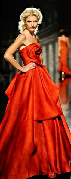 Rami Al-Ali. Wow! First of all, the warm red is my favorite.... more so than a cool red. This gown reminds one of glamorous confections of yesteryear. I simply love it! ....CH