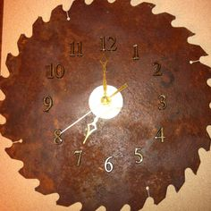 Old rusty saw blade makes a great clock for the shop.