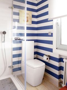 Interesting bathroom with horizontal stripes, modern commode and glass shower. I'd had wider stripes in my colors, pale peach and yellow. House Decoration Items, Toilet Decoration, Family Bathroom, Bathroom Wall, Glass Shower, Image House, Cladding, Kitchen And Bath, Home Renovation