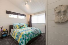 Tracy revives a kiwi icon | Habitat by Resene Aluminium Joinery, Timber Walls, White Carpet, Acoustic Panels, Black Kitchens, Home Renovation, Linen Bedding, Colorful Interiors, Living Area