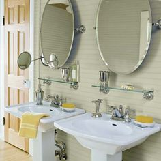 This master bath features salvaged original beadboard walls, a heart-pine floor, and his-and-hers sinks.