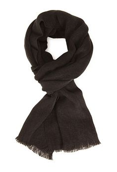 A must-have for fall, this classic woven scarf is complete with fringed trim. We love it over a cable knit sweater and distressed denim.