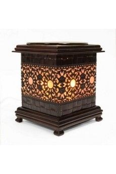 """Asian style oil warmer measures 6"""" tall. Simulated wood stand. Uses one 35 watt halogen bulb (included). Oil dish is removal for easy clean up."""