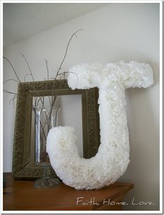 SO doing this. Super simple, super cheap! Coffee filter letters -- for the church doors?