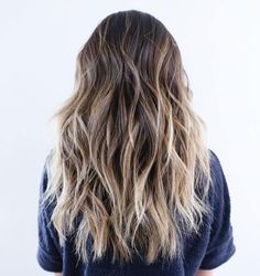 Long Choppy Hairstyle With Blonde Highlights. I really like this cut, but just shorter.