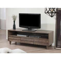 Update your home with a rustic charm with this Venetian 3-drawer entertainment center. Featuring plenty of storage and a country appeal, this versatile entertainment center is perfect for your living room.