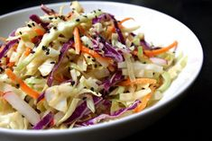 Recipe: Asian Slaw Salad with Miso Ginger Dressing     Miso-Ginger Dressing    1 inch ginger, finely grated  1 clove garlic, finely grated  2 tablespoons mellow miso  2 tablespoons rice wine vinegar (I used a seasoned rice vinegar)  1 tablespoon tamari  2 teaspoons toasted sesame oil, optional  3 tablespoon water