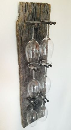 Stunning reclaimed wood wine glass rack with remarkable detail and an industrial edge. Takes any dining room or wine bar up a notch. Priced: