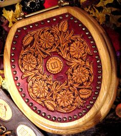 """Never thought of """"upholstering"""" a toilet seat lid! Leather Stamps, Leather Art, Custom Leather, Leather Design, Tooled Leather, Leather Bracers, Leather Tooling Patterns, Leather Pattern, Leather Craft Tools"""