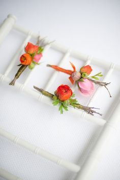 The rest of the boutonnieres will be varied construction using pink and orange ranunculus, orange spray roses, pink festival bush, yellow waxflowers and seasonal greenery (each a little different).