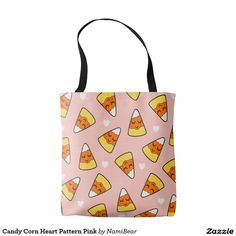 Candy Corn Heart Pattern Pink Tote Bag by NamiBear on Zazzle.com. This is a drawing of a candy corn with a smile on her face with hearts around her. It has a pink background.