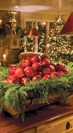 As simple & inexpensive way to bring some rustic Christmas cheer to your table - a bowl full of apples and evergreen tree trimmings. Noel Christmas, Primitive Christmas, Country Christmas, All Things Christmas, Winter Christmas, Natural Christmas, Christmas Colors, Beautiful Christmas, Simple Christmas