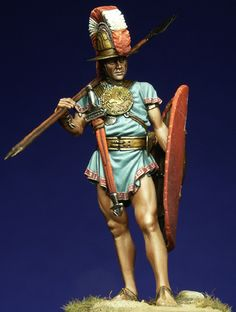 "Italian Warrior IV C. b.C.-The idea for this figurine comes from the statue of the ""warrior of Capestrano"" which was found in Abbruzzo ( L'Aquila ). The armour is typical of the italic warriors living in the Apennines area. The Oscan-Sabellas & Samnitic language were common to these populations that had to withstand the Roman expansion between the VI and the III century b.C. The chest is protected by the kardiophylax (literally hart protector) a bronze disc (front and back)."