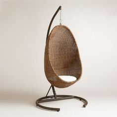 Retro yet marvelously modern, our exclusive Hanging Egg Chair provides the perfect nook to cozy up in. A sturdy seating solution, it's crafted of durable resin wicker, which is made to withstand the elements while exuding an authentically natural wicker look. With a base, chair and 100% spun polyester seat cushion, this unique chair is priced for a wonderful value.