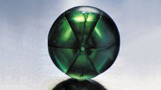 This 10.03-carat stone is a trapiche emerald. Its inclusions form rays in a star-like pattern. This well-executed cabochon cut shows off this unusual arrangement. - Courtesy Colombian Emeralds Co