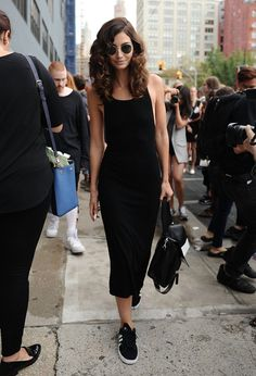 Pin for Later: 5 Women Show You How to Wear the Perfect Black Dress in Any City Brooklyn, NY This tea-length body-con has major '90s vibes, and pairing it with Adidas Campus sneakers makes it perfect for strolling through the borough.