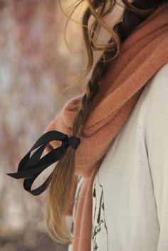 Like the contrast between the black ribbon and the soft pink of the scarf.
