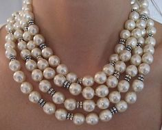 """Chanel Pearl & Diamond Sautoir Necklace..These vintage glass pearls are in mint condition. They are unusually long, measuring 71"""", perfect runway couture! They can be worn in several different lengths depending how many times they're wound around the neck. The crystal rondelles add a touch of glamour and sparkle to the soft white color of the pearls. This signed Chanel necklace is all hand knotted on silk. The pearls are in pristine condition. This necklace also comes in the original Chanel…"""