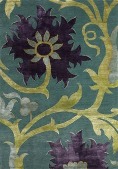New Moon Rug - Trinidad, rich aqua/wild blackberry. The over-sized flower motif is both eclectic and powerful in this contemporary rug.  Although this design is in the Mirage Collection, this particular piece features a wool background with silk designs.  This piece features tones of turquoise, lime green, aubergine purple and pale orange.