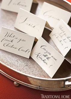 these place cards serve dual purpose, one side is guest's name, other side a question for guest to answer during dinner.