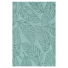 Stylishly anchor your patio seating group or define space in the den with this artfully crafted rug, showcasing a tropical plant motif.