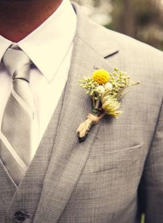The boutonnieres with the gray suits and striped tie!  LOVE!