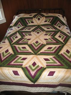log cabin star..hand quilted. Some day I will be able to quilt like this...