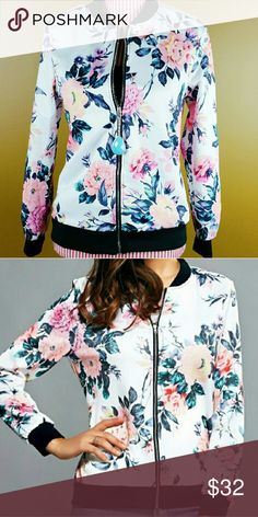 Floral Bomber Jacket Cute bomber jacket in a pretty pink and white floral. Silver zipped front. Very lightweight and perfect for Fall layering. Silky polyester material. NOTE: Tag displays a size larger than the actual fit. Please see measurements below.   Small - Bust: 38.58, Length: 24.41, Sleeves: 23.23 inches   Medium - Bust: 40.16, Length: 24.80, Sleeves: 23.62 inches   Large - Bust: 41.73, Length: 25.20, Sleeves: 24.02 inches   XL - Bust: 43.31, Length: 25.59, Sleeves: 24.41 inches…