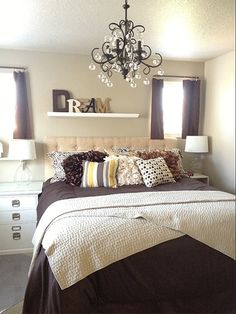 Handmade curtains, pillows, and tufted headboard. Personally painted wall color, shelf color, and letter color, and self-installed chandelier. (Note: There are additional items on my to do list / redo curtain length and bedside tables, but will remain as is for now.) What do you think?