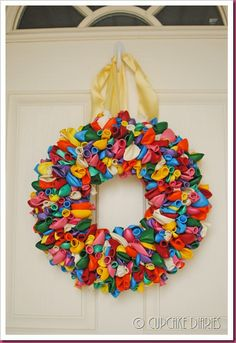 """Looks cool! One pinner said, """"I made this, however I used a foam wreath, and it took 288 balloons to make it look as full as I wanted it to. We will hang it on all birthdays now! Wreath Crafts, Diy Wreath, Birthday Fun, Birthday Parties, Birthday Celebrations, Birthday Ideas, Birthday Balloon Wreath, Birthday Wreaths, Crafts To Do"""