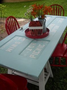 Upcycled door = picnic table....great color, too! So cute, no outdoor space where I live, but I like it!