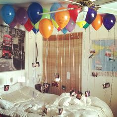 Did this for my roommates 22nd birthday! 22 balloons with pictures hanging from the strings and 22 reasons I love her written on the balloons! Got the idea from a pin I saw on here (: she loved it, and it was really fun and cheap to do!