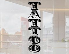 A vertical stack of the word tattoo for shop window displays each of the letters a arranged into a tower sticker to use in narrow windows The Tattoo Memes, Tattoo Signs, Vertical Tattoo, Tattoo Shop Decor, Ink Logo, S Logo Design, Gaming Tattoo, Window Signs, Sign Display