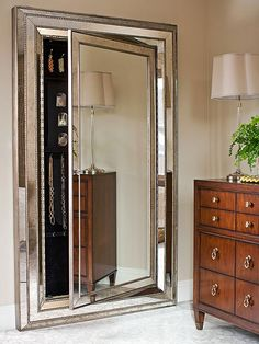 Conceal an organized jewelry closet in the bedroom with a beveled full-length mirror. The velvet-lined closet creates a custom space for bracelets, necklaces, rings, and earrings.