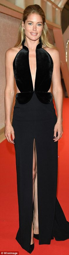 15cc42f5628b Glamorous  Model Doutzen Kroes teased a glimpse of her lithe limbs through  her dress s racy