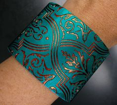 Handmade Polymer Clay Bracelet. This is a handmade Cuff, created from scratch using Polymer Clay and accented with acrylics, by adrianaallenllc.