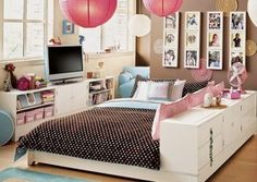 I love the set up on the room, that bed would be easy to make just buy a short long dresser and take the legs off, make a bed platform and paint. I like how functional it is, you can use it as a bed side table and storage and it makes a little couch