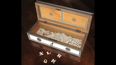 Box of ivory letters owned by Jane Austen. These were used for word games. British Library collection. EA.