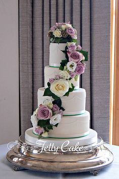Fresh Floral Cascade Wedding Cake | Flickr - Photo Sharing! Piped pearl swags with pretty vintage lilac fresh flowers cascading down the cake.