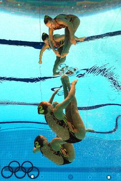 Mary Killman and Mariya Koroleva of the United States compete in the Women's Duets Synchronised Swimming Technical Routine on Day 9 of the London 2012 Olympic Games at the Aquatics Centre  on August 5, 2012 in London, England.