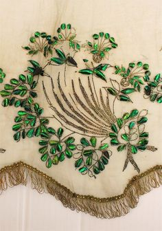 """Skirt (detail) of a Beetle Wing dress 1865-1875. The accompanying underskirt/petticoat is lost. The 5 piece Beetle Wing dress is owned by the """"Oudheidkamer Enschede"""" (Netherlands) and is preserved at the museumdepot of Museum TwentseWelle, Enschede (Netherlands). I work as Volunteer textielconservation at museum TwentseWelle and this dress is one of my favorites."""