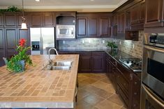 Tiles serve as one of the most popular options for designing kitchen countertops. Before you decide to install them, you must consider both its pros and cons to get a clearer picture. We'll start with discussing each of its components in detail, which will be followed by a brief comparison table. Click to learn more about tile countertops. Modern Kitchen Tiles, Concrete Kitchen, Kitchen Tops, Kitchen Flooring, Rustic Kitchen, Kitchen Backsplash, Kitchen Decor, Kitchen Ideas, Kitchen Designs