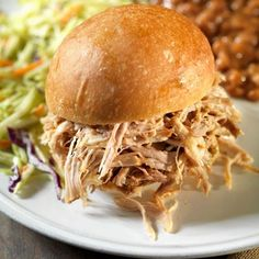 Pulled pork sandwiches are a favorite at UNC Tar Heels tailgating parties. Serve the sandwiches with slaw, hot sauce, baked beans, and potato salad. Tailgating Recipes, Tailgate Food, Tailgate Parties, Cooking Sauces, Cooking Recipes, Bread Recipes, Easy Recipes, Pork Sandwich, Sandwiches