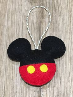 This Mickey Mouse inspired decoration will be a perfect addition to your Christmas tree this festive season. It will also look nice around your home. It has been designed and hand stitched by myself. It is made using good quality felt, lightly filled with toy filling and finished with gold coloured twine. It measures 14cm from top of the twine to the bottom of the decoration, 8.5cm from top to bottom of Mickey and 9cm wide. All items come from a smoke free and pet free home. All items have…