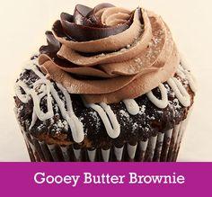 Gooey Butter Brownie  Cake: Gooey Butter Brownie Topping: Vanilla Glaze, Swirl of Ganache and Chocolate Buttercream and a Powder Sugar Dusting