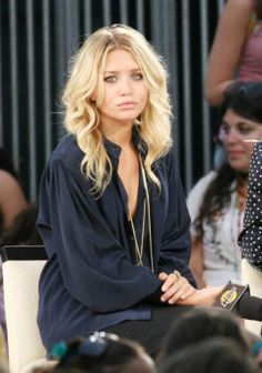 why do the olsen twins always have such perfect hair? ..oh wait...someone else does it for them.
